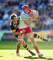 Sam Twomey of Harlequins looks to offload the ball after being tackled. Aviva Premiership match, between Wasps and Harlequins on October 2, 2016 at the Ricoh Arena in Coventry, England. Photo by: Patrick Khachfe / JMP