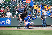 Home plate umpire Ryan Goodman and J.C. Boscan (7) of the Omaha Storm Chasers before the game against the Memphis Redbirds in Pacific Coast League action at Werner Park on April 22, 2015 in Papillion, Nebraska.  (Stephen Smith/Four Seam Images)