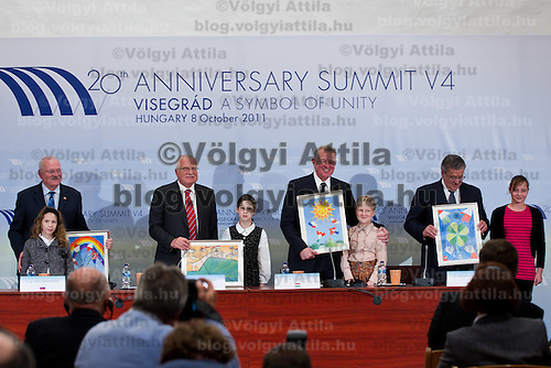 Presidents of Visegrad countries (V4), (L-R) Ivan Gasparovic of Slovakia, Vaclav Klaus of Czech Republic, Pal Schmitt of Hungary and Bronislaw Komorowski of Poland pose with drawings presented by local children during their summit in Visegrad, 55 km (34.2 miles) north of Visegrad, Hungary on October 08, 2011. ATTILA VOLGYI