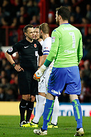 Leeds United FC players ask questions of referee, Stuart Attwell during the Sky Bet Championship match between Brentford and Leeds United at Griffin Park, London, England on 4 November 2017. Photo by Carlton Myrie.