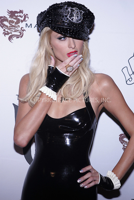 WWW.ACEPIXS.COM . . . . . ....November 23 2008, LA....Paris Hilton arriving at the opening night Of The Pussycat Dolls Lounge at the Viper Room on November 23, 2008 in West Hollywood, California.....Please byline: JOE WEST- ACEPIXS.COM.. . . . . . ..Ace Pictures, Inc:  ..(646) 769 0430..e-mail: info@acepixs.com..web: http://www.acepixs.com