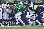 Oct 07, 2015; Eugene, OR, USA; Oregon Ducks running back Taj Griffin (5) tries to stay inbounds in front of California Golden Bears sideline at Autzen Stadium. <br /> Photo by Jaime Valdez