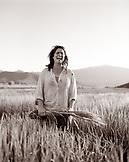 USA, California, Organic farmer holding grass in field, Fort Jones (B&W)
