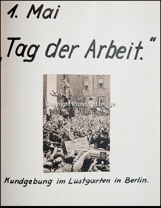BNPS.co.uk (01202 558833)<br /> Pic: Mullocks/BNPS<br /> <br /> ***Please Use Full Byline***<br /> <br /> 'Day of Work' Rally in Berlin with Hitler parading.<br /> <br /> Sinister archive illustrating the Nazi brainwashing of German youth comes to light...<br /> <br /> A chilling archive of an enthusiastic member of the Hitler Youth has emerged to highlight how the Nazi's brainwashed German children in the build up to WW2<br /> <br /> Helmut Nieboy kept detailed diaries during his time with the German equivalent of the Boy Scouts from 1933.<br /> <br /> Helmut also amassed a number of photographs of his time with the paramilitary group, showing the youngsters sitting around a campfire, marching and at rallies. <br /> <br /> The diaries also include incredibly detailed route marches as well as hand drawn portraits of the beloved Fuhrer with patriotic slogans.<br /> <br /> The archive, that also includes his Hitler Youth tent, knife and trumpet, are being sold by Mullock's Auctioneers of Shropshire.