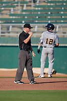 Umpire Lance Seilhamer calls Justin Jones (12) out at first during a Midwest League game betwee the Burlington Bees ad Lansing Lugnuts on July 18, 2019 at Cooley Law School Stadium in Lansing, Michigan.  Lansing defeated Burlington 5-4.  (Mike Janes/Four Seam Images)