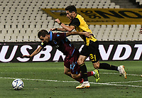 Trabzonspor's João Pereira (L) in action against AEK's Hélder Lopes (R) during of the UEFA Europa League play-off, 1st leg, soccer match between AEK Athens FC and Trabzonspor at the OAKA Spyros Louis Stadium in Athens, Greece on August 22, 2019.