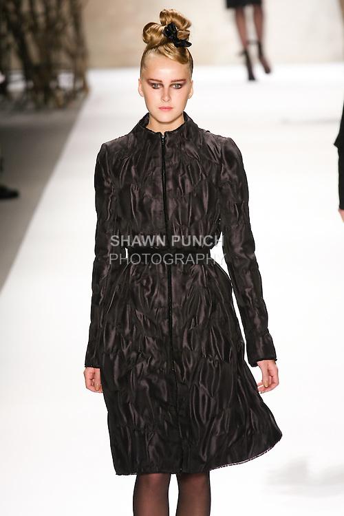 Lisanne de Jong walks runway in a Monique Lhuillier Fall 2011 outfit, during Mercedes-Benz Fashion Week Fall 2011.