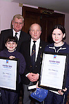 Maeve and Sarah McGuinness receiving thier awards of acknowledgement to acknowledge the use of Water Safety Best Practices resulting in the saving of lives from Frank Maher and Paul Hamlet, examiner at the Louth Water Safety awards night in the Bridgeford..Picture: Paul Mohan/Newsfile