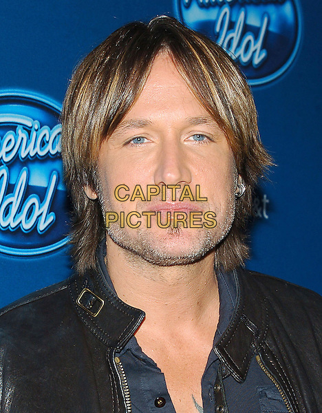 Keith Urban.American Idol premiere event held at Royce Hall at UCLA in Westwood, California, USA..9th January 2013                                                                   .headshot portrait blue shirt black leather stubble facial hair .CAP/DVS.©DVS/Capital Pictures.