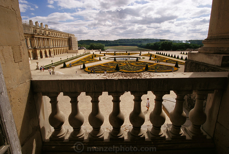 Versailles Palace formal garden seen from a balcony of the Palace. Paris, France.