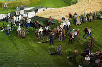 "27 JUL 2012 - LONDON, GBR - Actors playing farmworkers begin to tear up the rural scenery and props at the start of the ""Pandemonium"" section of the Opening Ceremony of the London 2012 Olympic Games in the Olympic Stadium in the Olympic Park, Stratford, London, Great Britain (PHOTO (C) 2012 NIGEL FARROW)"