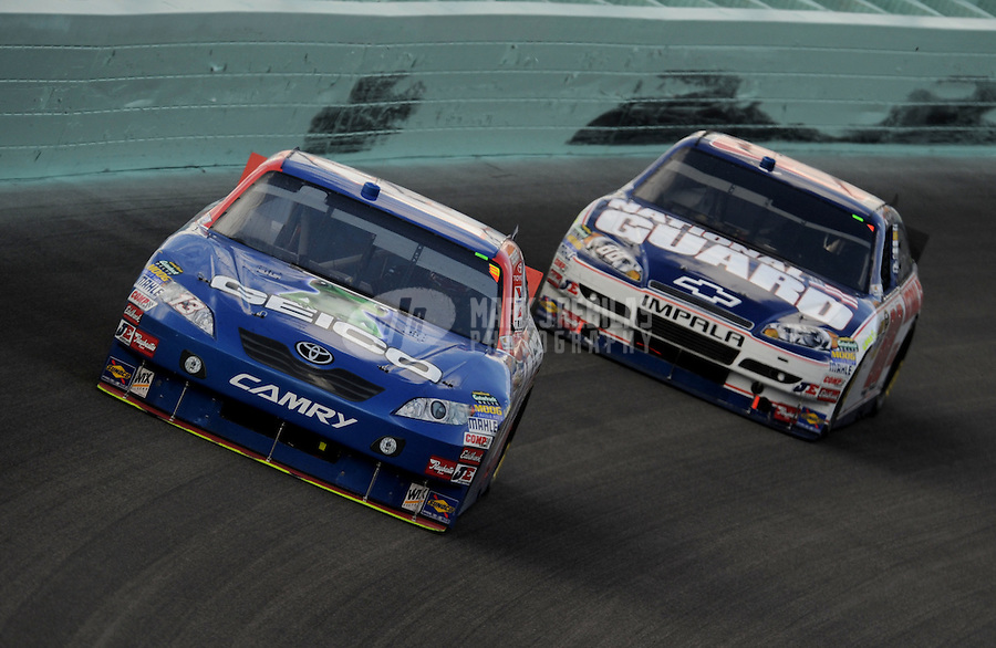 Nov. 21, 2010; Homestead, FL, USA; NASCAR Sprint Cup Series driver Casey Mears leads Dale Earnhardt Jr during the Ford 400 at Homestead Miami Speedway. Mandatory Credit: Mark J. Rebilas-