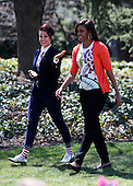 """US First Lady Michelle Obama arrives to read """"Oh, the things you can do that are good for you!"""" a Dr. Seuss inspired book, to children during the 2015 Easter Egg Roll on the South Lawn of the White House, in Washington, DC on April 06, 2015.  The event features live music, sports courts, cooking stations, storytelling and Easter Egg Rolling. (Pool / Aude Guerrucci)<br /> Credit: Aude Guerrucci / Pool via CNP"""