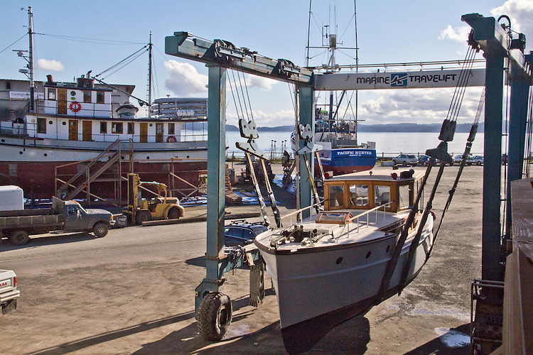 Port Townsend, Port Townsend Shipwrights Cooperative, yacht, Wood Duck, being returned to the water, Port of Port Townsend,    Boat Haven Marina, Puget Sound, Washington State, Jefferson County,