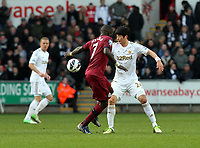 Pictured: Swansea's Ki Sung Yeung in action against Newcastle United. Here he takes on Moussa Sissoko <br />