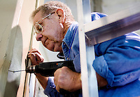 Pete Philp (cq, 214.739.5023), a volunteer and general handyman at St. Vincent de Paul Thrift Store drills a hole while hanging a speaker bracket in Dallas, Texas, Tuesday, March 25, 2008. The thrift store opened about four years ago and all proceeds go to the needy. They hope to earn a profit by next year...PHOTO/ MATT NAGER