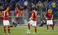 Calcio, Serie A: Roma vs Chievo Verona. Roma, stadio Olimpico, 7 maggio 2013..From left, AS Roma's Erik Lamela, Pablo Daniel Osvaldo and Leandro Castan react after ChievoVerona scored the winning goal in the last minutes of the Italian Serie A football match between AS Roma and ChievoVerona at Rome's Olympic stadium, 7 May 2013. ChievoVerona won 1-0..UPDATE IMAGES PRESS/Riccardo De Luca
