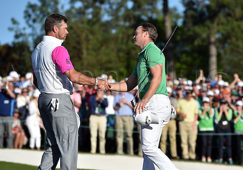 10.04.2016. Augusta, GA, USA.  Lee Westwood and Danny Willett shake hands after finishing their play during the final round of the Masters on Sunday, April 10, 2016, at Augusta National Golf Club in Augusta, Ga Willett capatalized on Spieths meltdown on holes 10-12 and won the tournament by 3 strokes on -5.