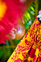 Close up of a hula dancer shaking her uli uli implement