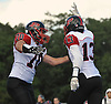 Donovan Pepe #13 of Plainedge, right, gets congratulated by Dylan Kocoris #70 after he made a reception for a touchdown in the second quarter of a Nassau County Conference III varsity football game against host Roosevelt High School on Saturday, Oct. 13, 2018.