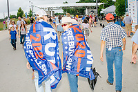 People wearing Trump flags walked ahead of the media scrum as Democratic presidential candidate Bernie Sanders walked along the midway at the Iowa State Fair in Des, Moines, Iowa, on Sun., Aug. 11, 2019.