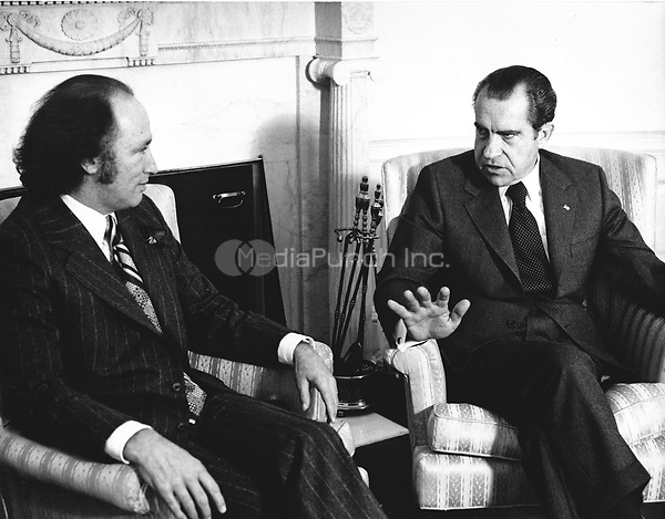United States President Richard M. Nixon, right, meets Prime Minister Pierre Elliott Trudeau of Canada, left in the Oval Office of the White House in Washington, DC on December 6, 1971.  The President consulted with the Prime Minister on his pending tcp to China.  Trudeau is expected to be in Washington for two days and then return to Canada.<br /> Credit: Benjamin E. &quot;Gene&quot; Forte / CNP /MediaPunch