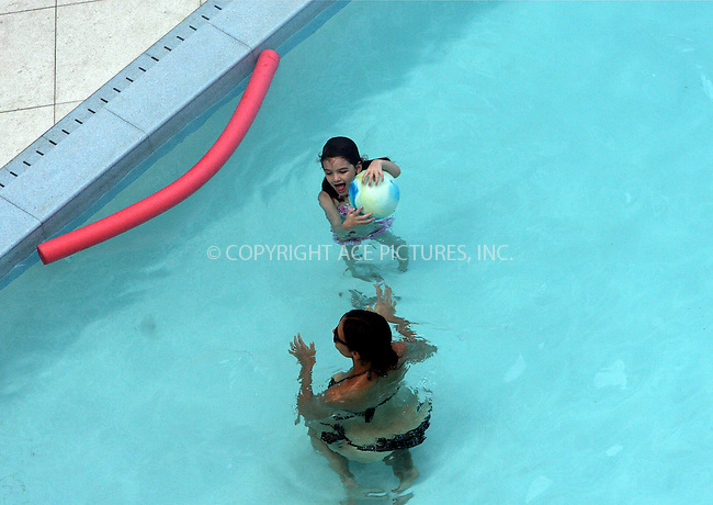 WWW.ACEPIXS.COM . . . . .  ....July 17 2011, Miami....Actress Katie Holmes and her daughter Suri Cruise went for a swim in their hotel pool on July 17 2011 in Miami beach.....Please byline: NANCY RIVERA- ACEPIXS.COM.... *** ***..Ace Pictures, Inc:  ..Tel: 646 769 0430..e-mail: info@acepixs.com..web: http://www.acepixs.com
