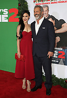 WESTWOOD, CA - NOVEMBER 5: Rosalind Ross and Mel Gibson at the premiere of Daddy's Home 2 at the Regency Village Theater in Westwood, California on November 5, 2017. Credit: Faye Sadou/MediaPunch