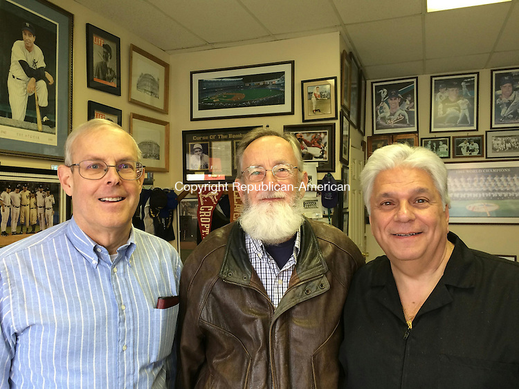 WATERBURY, CT- 12 January 2016- 011216BJ01-- The Rev. Martin Kiesel of Waterbury, left, and Russell Andrew of Naugatuck, center, at Anthony Monteiro's barber shop on Bank Street on Tuesday. The three spoke about what they would do if the won the Powerball jackpot however Kiesel isn't buying a ticket for moral and religious reasons. Bruno Matarazzo Jr. Republican-American