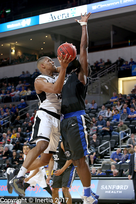 SIOUX FALLS, SD: MARCH 5: Tre'Shawn Thurman #15 from Omaha tries to get the shot up against Brent Calhoun #45 from Fort Wayne during the Summit League Basketball Championship on March 5, 2017 at the Denny Sanford Premier Center in Sioux Falls, SD. (Photo by Dave Eggen/Inertia)