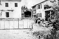 BNPS.co.uk (01202 558833)Pic:  EzraFamily/BNPS<br /> <br /> Post war picture showing the building occupied by the Germans (left) and the barn in which the villagers were held (far right).<br /> <br /> Brighton nonagenarian Gabriella Ezra(91) has finally been recognised for her wartime heroics...<br /> <br /> The extraordinary story of how a teenage girl saved an entire village from being executed by the Nazis has come to light after she finally received a gallantry award nearly 74 years later.<br /> <br /> Fearless Gabriella Ezra, 91, who lives in Brighton, Sussex, intervened to stop her father Luigi and 37 other inhabitants of a rural village in her native Italy from being massacred by a firing squad during the chaotic last days of WW2.<br /> <br /> She has now been awarded an Italian Star of Italy medal after her son Mark wrote to the Italian embassy to make them aware of her remarkable actions on the morning April 28, 1945.<br /> <br /> Gabriella, who was 17 years old at the time, chased after a German officer and pleaded with him to show mercy to the villagers of Capella di Scorze, near Venice, who had been rounded up and locked in a cowshed.<br /> <br /> The Germans were after retribution following an attack on their men by Italian partisans which had left several of them wounded.