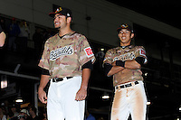 Quad Cities River Bandits starting pitcher Lance McCullers #23 participating in a live auction for his jersey with Carlos Correa #1 looking on after a game against the Wisconsin Timber Rattlers on May 24, 2013 at Modern Woodmen Park in Davenport, Iowa.  Quad Cities defeated Wisconsin 4-3  (Mike Janes/Four Seam Images)