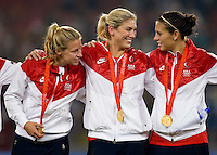 USWNT players Aly Wanger, Hope Solo, and Carli Lloyd celebrate after  playing for the gold medal at Workers' Stadium.  The USWNT defeated Brazil, 1-0, during the 2008 Beijing Olympic final in Beijing, China.