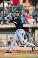 Andy Yerzy (38) of the Missoula Osprey follows through on his swing against the Billings Mustangs at Dehler Park on August 21, 2017 in Billings, Montana.  The Osprey defeated the Mustangs 10-4.  (Brian Westerholt/Four Seam Images)