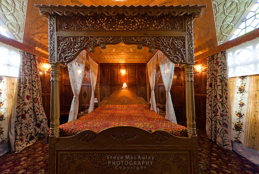 Interior views of master bedroom on traditional Kashmiri houseboat, Dal Lake, Srinagar, Kashmir, India.