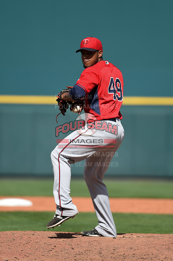 Minnesota Twins pitcher Lester Oliveros (49) during a Spring Training game against the Pittsburgh Pirates on March 13, 2015 at McKechnie Field in Bradenton, Florida.  Minnesota defeated Pittsburgh 8-3.  (Mike Janes/Four Seam Images)