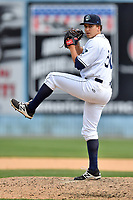 Asheville Tourists pitcher Matt Dennis (30) delivers a pitch during a game against the Greensboro Grasshoppers at McCormick Field on April 30, 2017 in Asheville, North Carolina. The Grasshoppers defeated the Tourists 7-0. (Tony Farlow/Four Seam Images)