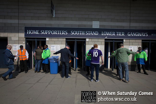 Tottenham Hotspur 4 Watford 0, 08/04/2017. White Hart Lane, Premier League. Supporters entering the turnstiles at the South Stand before Tottenham Hotspur took on Watford in an English Premier League match at White Hart Lane. Spurs were due to make an announcement in April 2016 regarding when they would move out of their historic home and relocate to Wembley as their new stadium was completed. Spurs won this match 4-0 watched by a crowd of 31,706, a reduced attendance figure due to the ongoing ground redevelopment. Photo by Colin McPherson.