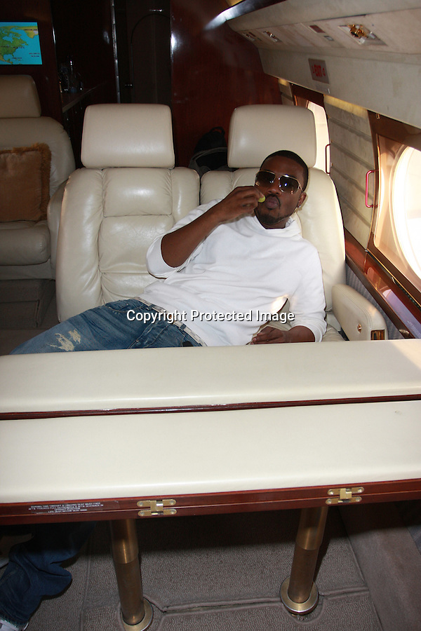 "January 15th 2011...Singers Brandy and Ray J. Norwood leaving in a private jet plane out of Long Beach Airport.They are heading to Las Vegas to celebrate Ray J's 30th Birthday.The man in the blue shirt is VP Michael J. Ogulnik, who takes care of private celebrity jet trips .through ""Air Rutter International. .Brandy was wearing some funky leather medieval sandals ..AbiliytFilms@yahoo.com.805-427-3519.www.AbilityFilms.com"