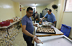 "Palestinian volunteers prepare rice and meats for distribution to the poor inside ""Nablus Takiya"" which was founded in 2012 AD, and provides food for over than 1600 families daily during the holy Muslim month of Ramadan in the West Bank city of Nablus on May 21, 2018. Ramadan is sacred to Muslims because it is during that month that tradition says the Koran was revealed to the Prophet Mohammed. The fast is one of the five main religious obligations under Islam. Muslims around the world will mark the month, during which believers abstain from eating, drinking, smoking and having sex from dawn until sunset. Photo by Shadi Jarar'ah"