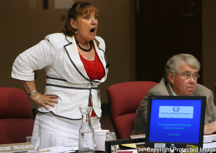 Tri-City Medical Center trustee Charlene Anderson yells in frustration in May, 2009, at the crowd as they reacted to the trustees not forming a task force to address quality of patient care at the facility.  photo for the North County Times