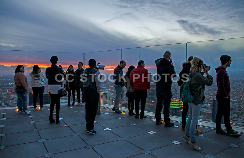 Tourists Looking at Los Angeles Skyline at Dusk
