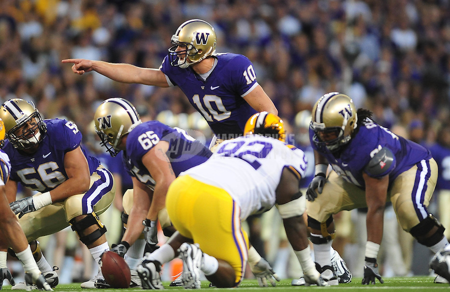 Sept. 5, 2009; Seattle, WA, USA; Washington Huskies quarterback (10) Jake Locker calls a play in the first half against the LSU Tigers at Husky Stadium. Mandatory Credit: Mark J. Rebilas-