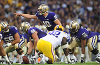 Sept. 5, 2009; Seattle, WA, USA; Washington Huskies quarterback (10) Jake Locker calls a play in the first half against the LSU Tigers at Husky Stadium. Mandatory Credit: Mark J. Rebilas-