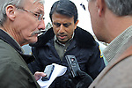 Governor Bobby Jindal of Louisiana takes questions from reporters while touring a neighborhood devastated by floods last summer in Cedar Rapids, Iowa on November 22, 2008.