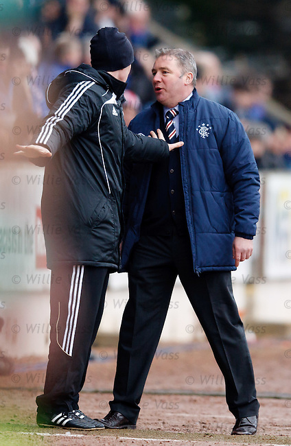Fourth official Brian Colvin restrains Ally McCoist as the Rangers manager seeks out his St Johnstone counterpart after an angry exchange on the touchline