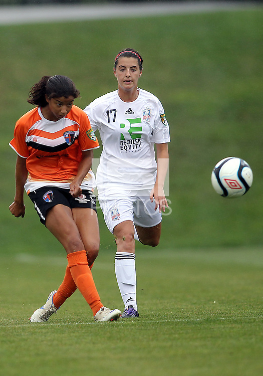 BOYDS, MARYLAND - July 21, 2012:  Rachel Baer (2) of Charlotte Lady Eagles passes away from Ariana Aston (17) of the Long Island Roughriders during a W League Eastern Conference Championship semi final match at Maryland Soccerplex, in Boyds, Maryland on July 21.