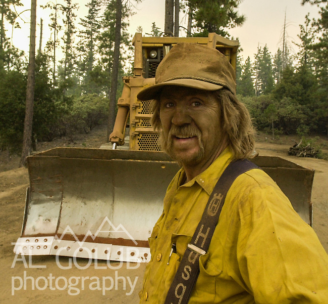 August 21, 2001 Coulterville, California  -- Creek Fire – Bulldozer operator Steve Fulton takes a moment after cutting firebreak on Cuneo Road.  The Creek Fire burned 11,500 acres between Highway 49 and Priest-Coulterville Road a few miles north of Coulterville, California.