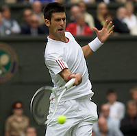 Novak Djokovic (SRB) (4) against Julien Benneteau (FRA) in the first round of the Gentlemen's Singles. 6-7 7-6 6-2 6-4 ..Tennis - Wimbledon - Day 9 - Wed 1st July 2009 - All England Lawn Tennis Club  - Wimbledon - London - United Kingdom..Frey Images, Barry House, 20-22 Worple Road, London, SW19 4DH.Tel - +44 20 8947 0100.Cell - +44 7843 383 012