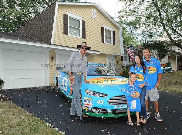 Bollingbrook, IL-Racing legend, Ricard Petty greets a veteran military family to give-a-way a house, free and clear, in Bollingbrook, IL.  The give-a-way was in conjunction with Eckrich, Operation Homefront and Wells Fargo.